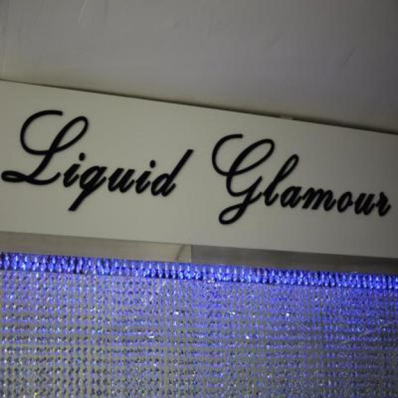Glamorous signs at sophisticated new Liquid Glamour salon and boutique
